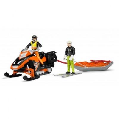 Snowmobil con conductor y trineo con esquiador - escala 1:16